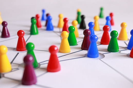 close up photography of yellow, green, red, and brown plastic game pieces connected by lines